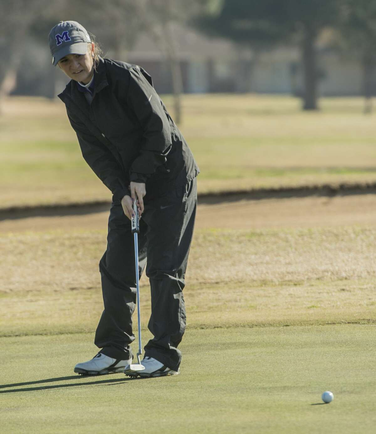 Midland High's Faith DeLaGarza follows her putt Friday 02-24-17 during the Tall City Invitational at Greentree Country Club. Tim Fischer/Reporter-Telegram