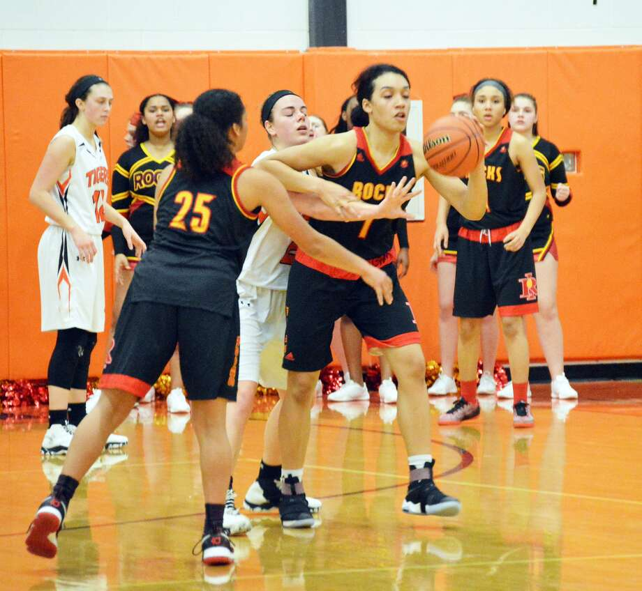 Edwardsville junior Rachel Pranger, center, tries to steal the ball away from Rock Island's Brea Beal.