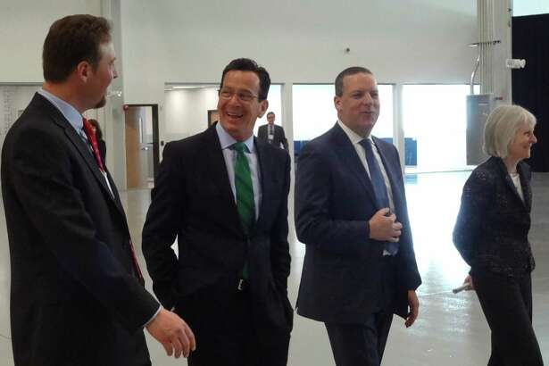 Novitex CEO John Visentin, center right, leads Gov. Dannel P. Malloy on a March 2015 tour of the Stamford-based company's document processing facility in Windsor.
