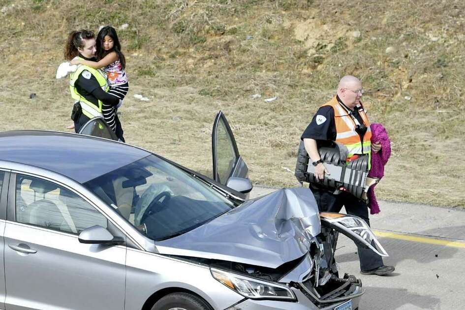 Emergency responders carry Aylin Sofia Hernandez after a high-speed pursuit with police ended with an accident on Interstate 99 northbound at the Shiloh Road interchange in Pennsylvania. The girls father, Oscar Hernandez, who was wanted for a fatal stabbing in Bridgeport, Conn., was captured at the scene.