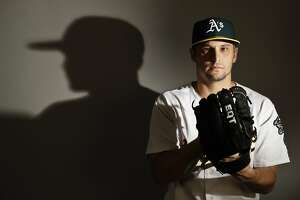 This is a 2017 photo of starting pitcher Kendall Graveman of the Oakland Athletics baseball team poses for a portrait. This image reflects the Athletics active roster as of Wednesday, Feb. 22, 2017, when this image was taken. (AP Photo/Chris Carlson)