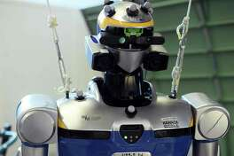 """A humanoid robot is pictured at the Laboratory for Analysis and Architecture of Systems (LAAS), a dependent of the French National Center for Scientific Research (CNRS), on February 1, 2017 in Toulouse, southwestern France, as part the presentation to the press of Pyrene, """"the first"""" humanoid robot. This latest generation robot is an anthropomorphic robot measuring 1.75m and weighing 100kg, and is capable of performing 32 independent articular movements.  / AFP PHOTO / REMY GABALDAREMY GABALDA/AFP/Getty Images"""