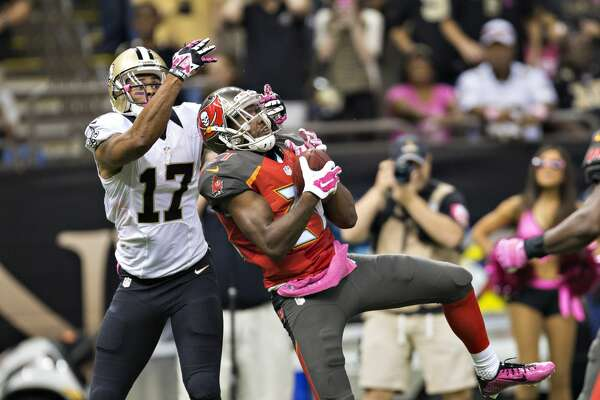 NEW ORLEANS, LA - OCTOBER 5:  Alterraun Verner #21 of the Tampa Bay Buccaneers intercepts a pass in front of Robert Meacham #17 of the New Orleans Saints at Mercedes-Benz Superdome on October 5, 2014 in New Orleans, Louisiana.  The Saints defeated the Buccaneers 37-31.  (Photo by Wesley Hitt/Getty Images)