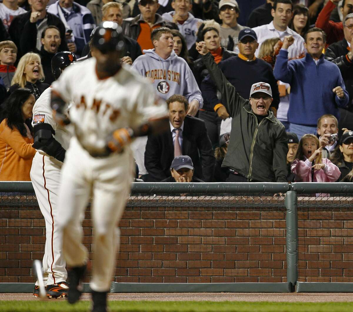 While Yankee fan Billy Crystal (seated with hat) remains quiet Robin Williams emotes as Giants batter Ray Durham is walked by Yankee pitcher Kei Igawa to load the bases in the fifth inning as the Giants play the Yankees at AT&T Park in 2007.