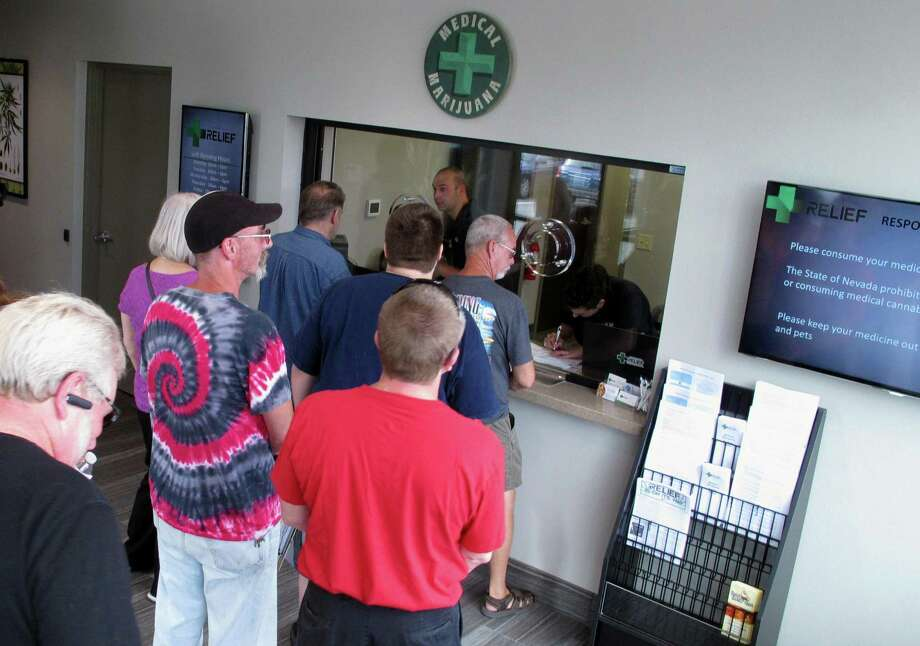 People line up to legally purchase medical marijuana at the Silver State Relief dispensary in Sparks, Nev. Nevada still plans to launch recreational marijuana sales in July despite warnings this week of a federal crackdown by the administration of President Donald Trump. Photo: Associated Press /File Photo / Copyright 2016 The Associated Press. All rights reserved. This material may not be published, broadcast, rewritten or redistribu
