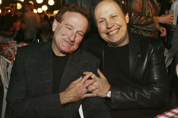 "Actors Robin Williams (L) and Billy Crystal pose at the afterparty for the premiere of Columbia Picture's ""RV"" on April 23, 2006 in Los Angeles, California. (Photo by Kevin Winter/Getty Images)"