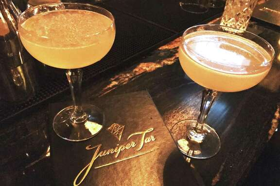Cocktails at Juniper Tar. Left, the Burning in Effigy with tequila blanco, Stega, creme de cacaso, Ancho Reyes and lemon. Right, the Gold Medal Match, with Cachaça, orgeat, Kirchwasser and lime.