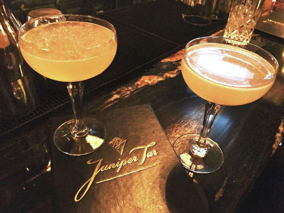 Cocktails at Juniper Tar. Left, the Burning in Effigy with tequila blanco, Stega, creme de cacaso, Ancho Reyes and lemon. Right, the Gold Medal Match, with Cachaca, orgeat, Kirchwasser and lime. Photo: Emily Spicer / San Antonio Express-News