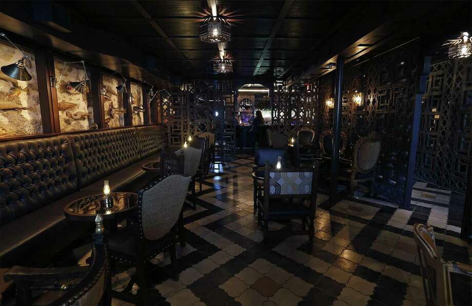 Downstairs took a former storage space and converted it into an intimate speakeasy lounge Photo: Kin Man Hui /Staff Photographer / ©2017 San Antonio Express-News