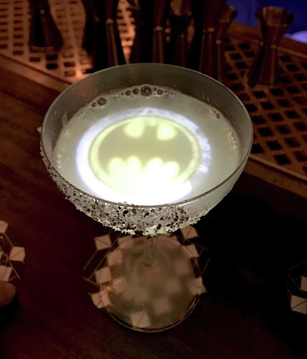 The Batman of Mexico cocktail, with tequila, corn, chile and lime, at Downstairs, the bar under The Esquire Tavern. The bat signal comes from a keychain light with which the bartenders are equipped and which they activate when the cocktail is served - at least the first time.