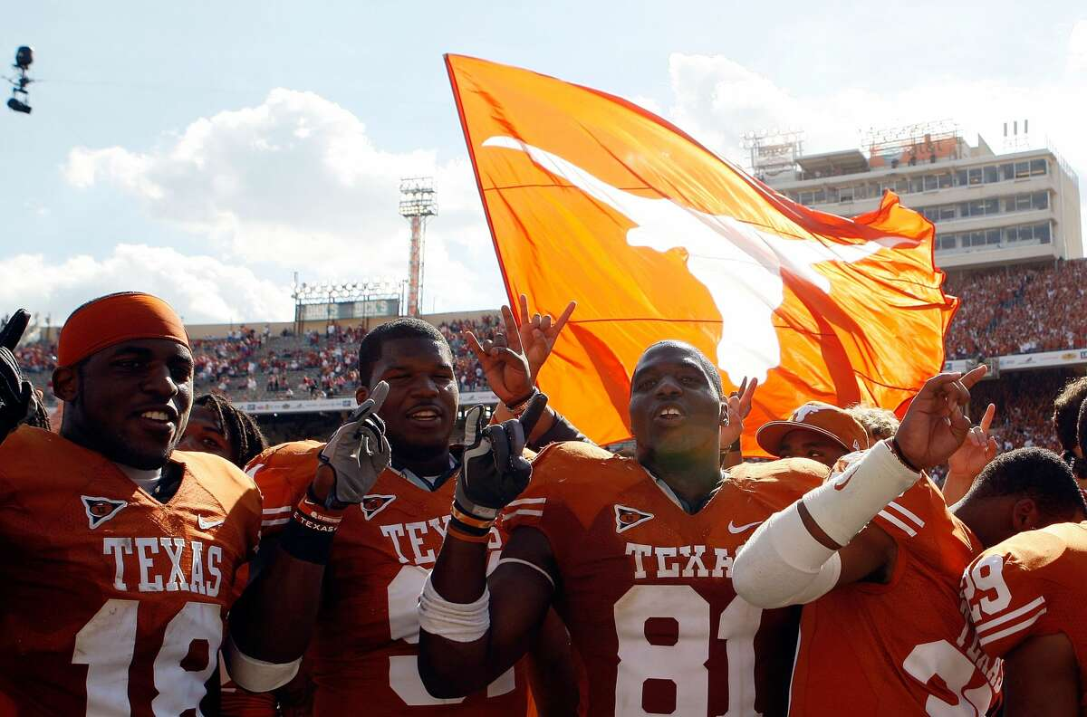 DALLAS - OCTOBER 17: (L-R) Emmanuel Acho #18, Kheeston Randall #91 and Sam Acho #81 of the Texas Longhorns celebrate a win against the Oklahoma Sooners at Cotton Bowl on October 17, 2009 in Dallas, Texas. (Photo by Ronald Martinez/Getty Images)