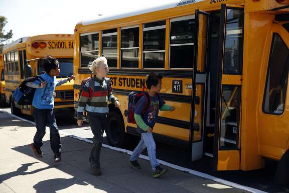 Students board a bus at Lakeshore Alternative School in San Francisco, Calif., on Tuesday, April 14, 2015.