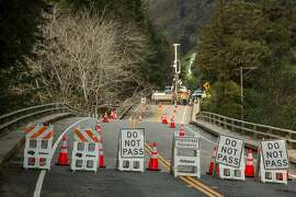 Looking North on Highway 1, the Pfeiffer Canyon Bridge is sinking and closed to cars and pedestrian traffic. The Big Sur community is looking into alternative routes so residents can access their homes and work.