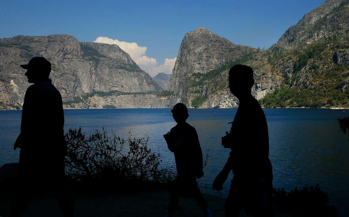 Visitors explore the shoreline of Hetch Hetchy reservoir in Yosemite National Park. California's State Water Resources Control Board adopted new regulations on March 6 that allow treated recycled water to be added to reservoirs used for drinking water.