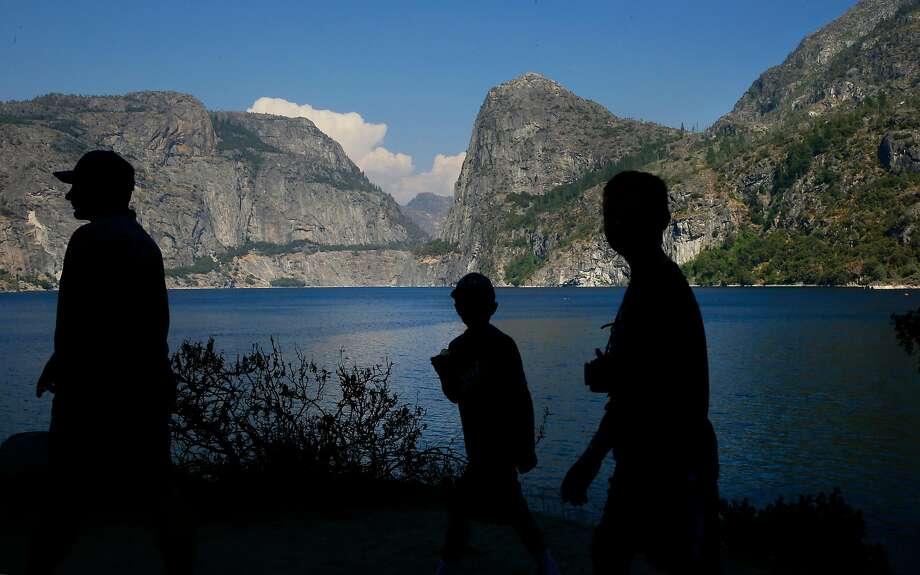 Visitors explore the shoreline of Hetch Hetchy reservoir in Yosemite National Park, California, on Thurs. July 28, 2016.  Mountain Tunnel, a key piece of the Hetch Hetchy water system is at risk of collapse, so this summer, the San Francisco Public Utilities Commission is preparing to repair the 19-mile-long tunnel just outside of Yosemite in a steep, hard-to-access wilderness area. Photo: Michael Macor, The Chronicle