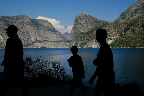 Visitors explore the shoreline of Hetch Hetchy reservoir in Yosemite National Park, California, on Thurs. July 28, 2016.  Mountain Tunnel, a key piece of the Hetch Hetchy water system is at risk of collapse, so this summer, the San Francisco Public Utilities Commission is preparing to repair the 19-mile-long tunnel just outside of Yosemite in a steep, hard-to-access wilderness area.