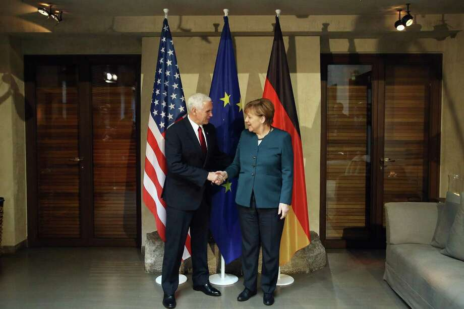 U.S. Vice President Mike Pence and German chancellor Angela Merkel shake hands at the 2017 Munich Security Conference on Feb. 8 in Munich, Germany. There may be a useful strategy in having an unpredictable president but grownups in the cabinet who, together, can play good cop, bad cop. Photo: Johannes Simon / / 2017 Getty Images