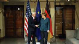 U.S. Vice President Mike Pence and German chancellor Angela Merkel shake hands at the 2017 Munich Security Conference on Feb. 8 in Munich, Germany. There may be a useful strategy in having an unpredictable president but grownups in the cabinet who, together, can play good cop, bad cop.