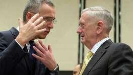 NATO Secretary General Jens Stoltenberg, left, speaks with U.S. Secretary of Defense James Mattis before the NATO Defense Ministers' meeting in Brussels on February 16. , 2017. Mattis' message: NATO allies must pull more weight when it comes to defense spending.