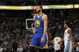 Golden State Warriors center JaVale McGee (1) in the second half of an NBA basketball game Monday, Feb. 13, 201, in Denver. The Nuggets won 132-110. (AP Photo/David Zalubowski)