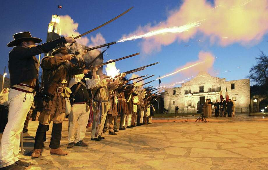 """Members of the San Antonio Living History Association fire muskets on March 7, 2014 in front of the Alamo during the """"Dawn at the Alamo"""" ceremony on the 178th anniversary of the battle for Texas independence. A master-plan reimagining of the site is generating plenty of debate. Photo: Kin Man Hui /San Antonio Express-News / ©2013 San Antonio Express-News"""
