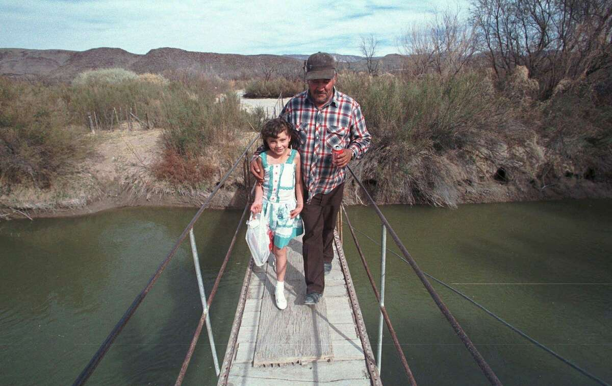 Once upon a time - this photo is from 1998 - there was a bridge that crossed the Rio Grande and connected Candelaria, Texas to San Antonio Del Bravo in Mexico. It's the one Maria Evagelina Garza and her grandfather Vicente dela O crossed in this February 1998 file photo. It no longer exists, thanks to our panic over border security.