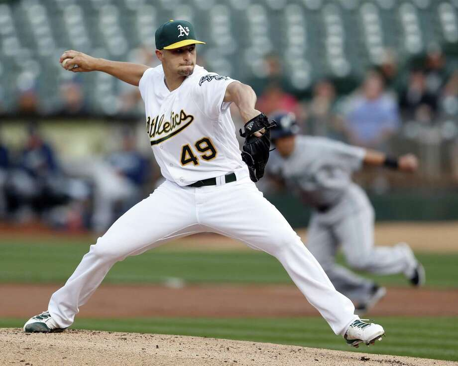 Oakland Athletics' Kendall Graveman delivers in 1st inning against Seattle Mariners during MLB game at Oakland Coliseum in Oakland, Calif., on Monday, May 2, 2016. Photo: Scott Strazzante / The Chronicle / ONLINE_YES