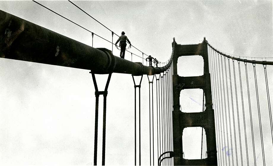 Three Cal Poly students climb the cables of the Golden Gate Bridge, August 30, 1977.