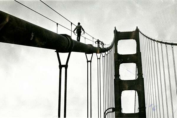 3 Cal Poly students climb the cables of the Golden Gate Bridge, on a lark Photo taken by Sgt. James C. Dukes, California Highway patrol  Photo ran September 1, 1977, P. 18