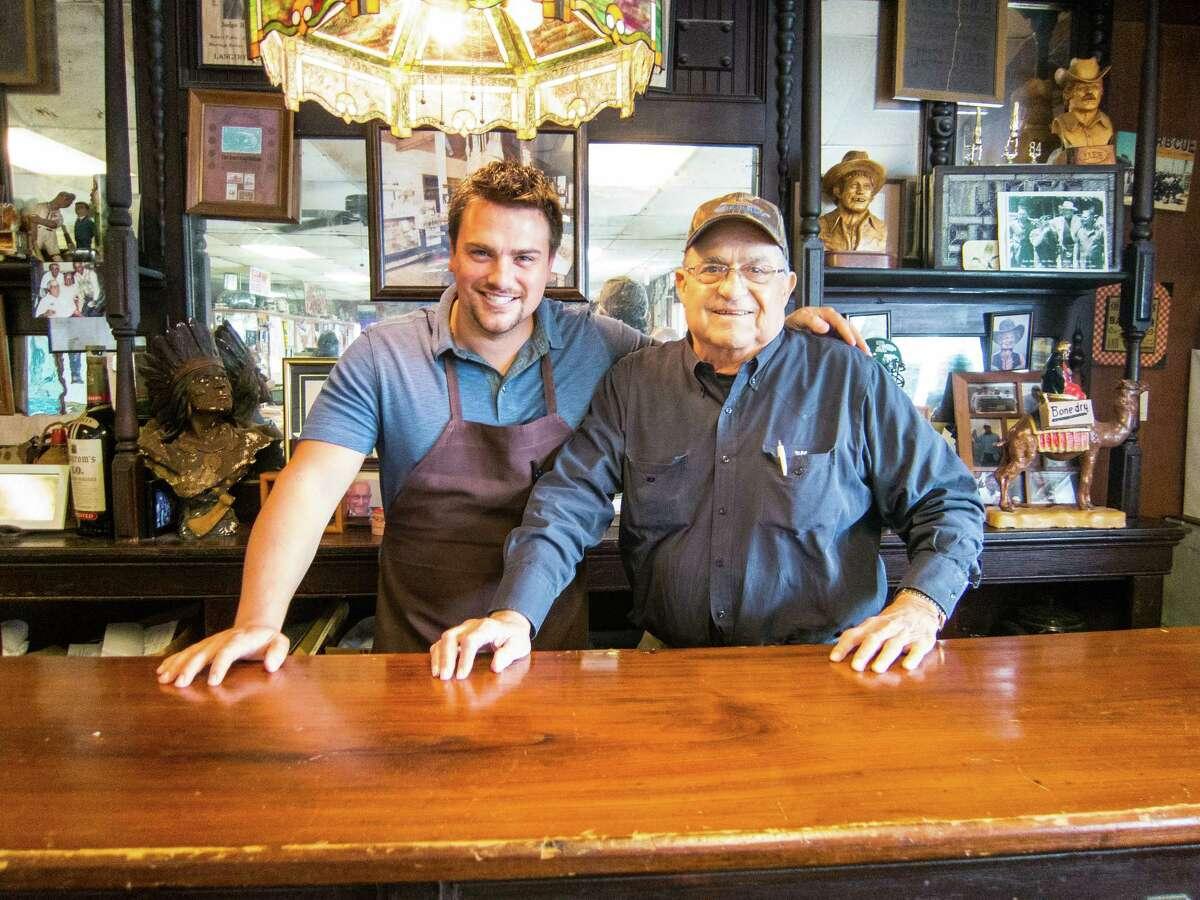 Pitmaster Josh Scott, left, with Jerry Pizzitola atPizzitola's Bar-B-Cue