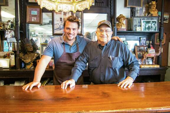 Pitmaster Josh Scott, left, with Jerry Pizzitola at Pizzitola's Bar-B-Cue