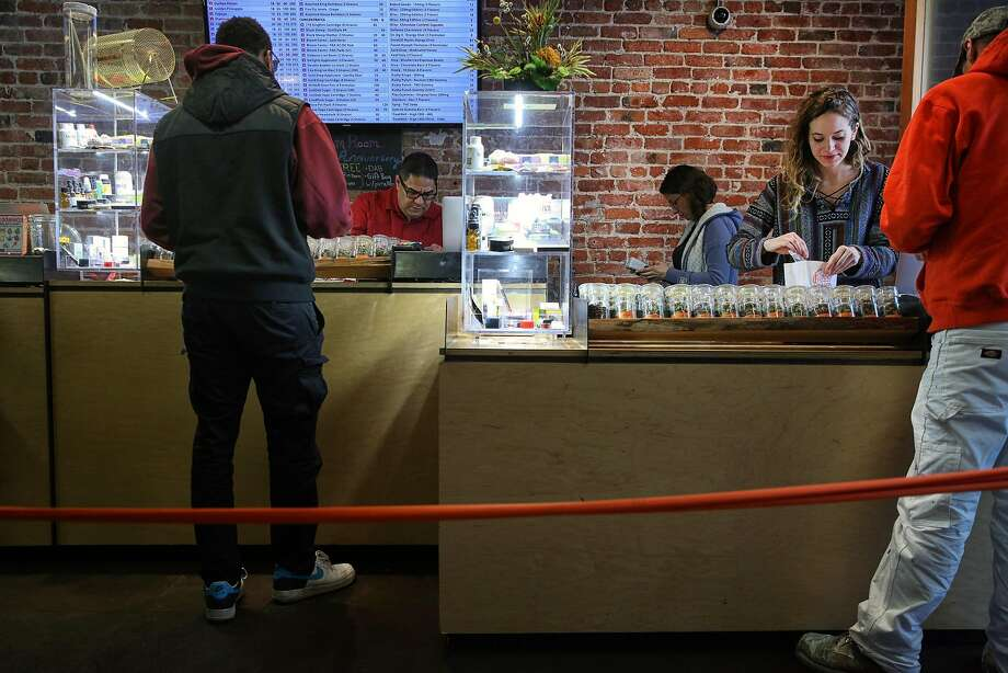 Consultant Rafael Vasquez (second from left), budtender Melissa Robertson and Assistant Manager Kacie Schwarze help customers at the Bloom Room Cannabis Collective in S.F. Photo: Santiago Mejia, The Chronicle
