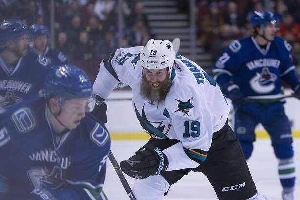 San Jose Sharks center Joe Thornton (19) chases down Vancouver Canucks defenseman Troy Stecher (51) during first-period NHL hockey game action in Vancouver, British Columbia, Thursday, Feb. 2, 2017. (Jonathan Hayward/The Canadian Press via AP)