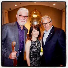 SF Giants announcers Mike Krukow (at left) with Giants Community Fund director Sue Peterson and Duane Kuiper at the Guardsmen Celebrity Sports Auction. Feb. 9, 2017.