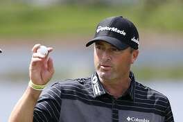 Ryan Palmer acknowledges the crowd as he finishes the second round of the Honda Classic golf tournament, Friday, Feb. 24, 2017, in Palm Beach Gardens, Fla. (AP Photo/Wilfredo Lee)