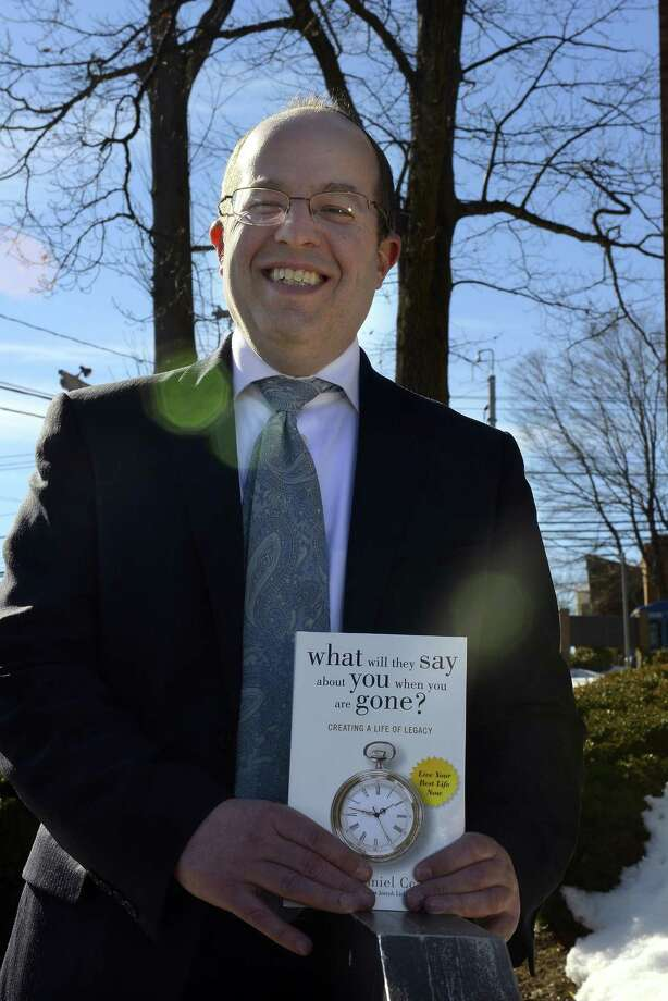 """Rabbi Daniel Cohen of Congregation Agudath Sholom is photograph outside the temple in Stamford on Feb. 17, 2017. This month Cohen released his first book, """"What Will They Say About You When You are Gone?"""", a motivational book geared towards helping people create more moral lives in society. Photo: Matthew Brown / Hearst Connecticut Media / Stamford Advocate"""