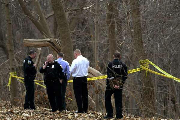 Schenectady Police investigate the finding of a body in a treed area south of Wyllie Street Friday  Feb. 24, 2017 in Schenectady, N.Y.  (Skip Dickstein/Times Union)