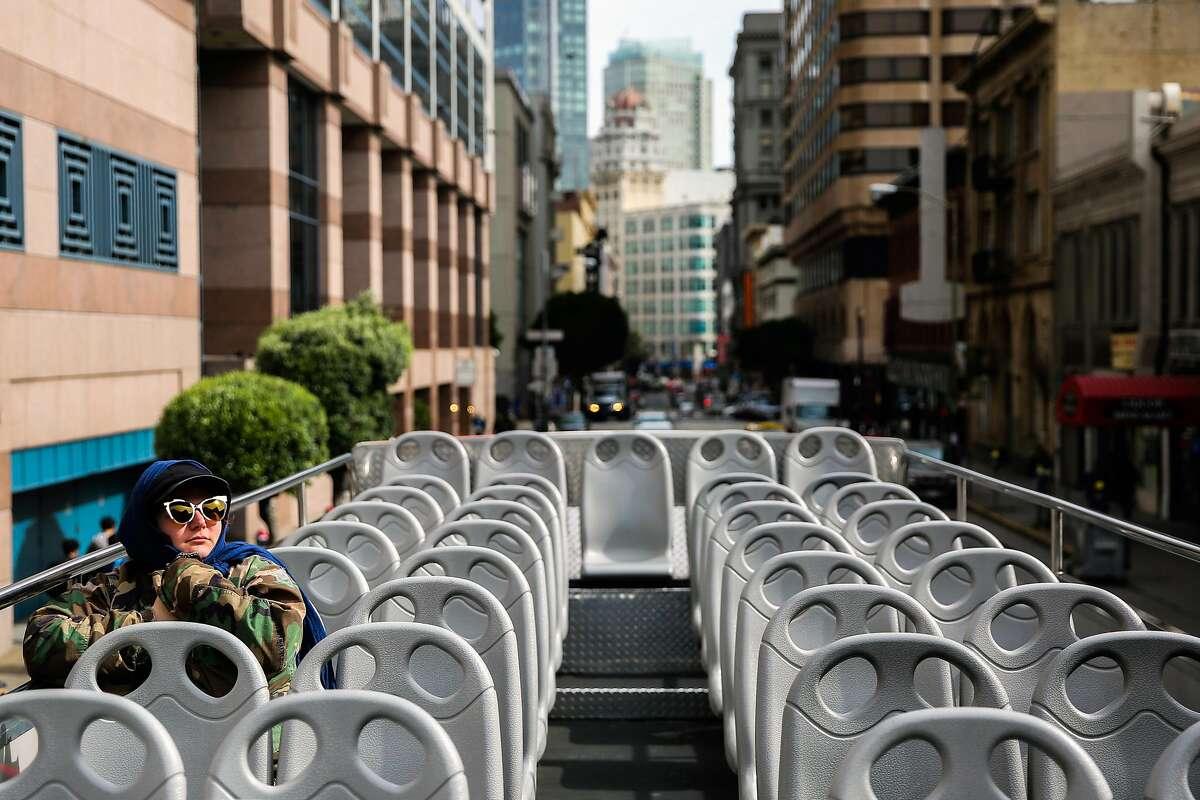 Tourist Fikreta Romano, of Brooklyn, New York, rides on a City Sightseeing tour bus in San Francisco, California, on Wednesday, Feb. 22, 2017.