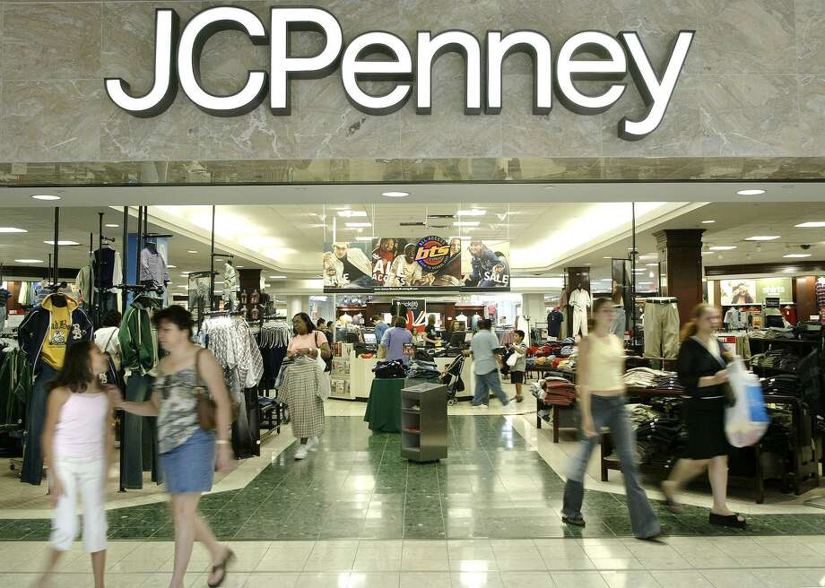 Customers walk out of a J.C. Penny department store in Dallas. J.C. Penney now expects to report a loss of 40 cents to 45 cents a share in the third quarter, when excluding some items. The company will release results on Nov. 10. Photo: Associated Press File Photo / AP2005