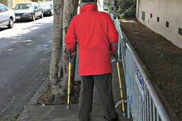 Bob Planthold uses braces and crutches to get around the neighborhood. He said that the Prosper Street's barricades make it nearly impossible—not to mention dangerous—to travel along the sidewalk.