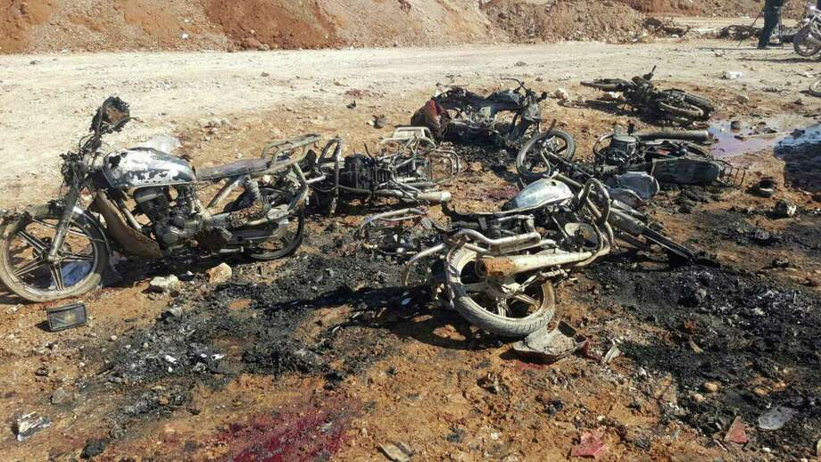 Burned motorcycles mark the site where a suicide attacker blew up his small pickup truck outside a security office, where civilians from al-Bab - trying to go home - had gathered.  Photo: Uncredited, HONS / Thiqa News Agency