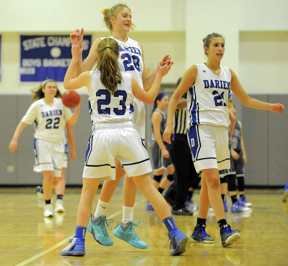 Darien Katie Ramsey (20) and Hailey King (23) celebrate the Blue Wave 53-52 win over West Haven in a CIAC Class LL girls basketball state qualifier at Darien High School on Feb. 24, 2017. Photo: Matthew Brown / Hearst Connecticut Media / Stamford Advocate