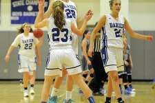 Darien Katie Ramsey (20) and Hailey King (23) celebrate the Blue Wave 53-52 win over West Haven in a CIAC Class LL girls basketball state qualifier at Darien High School on Feb. 24, 2017.
