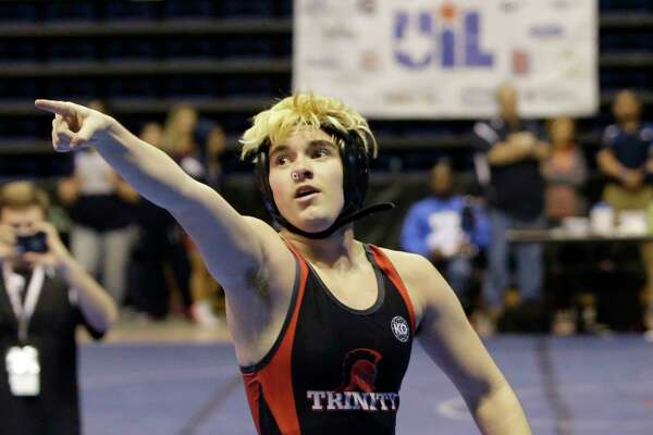Mack Beggs, top, a transgender wrestler from Euless Trinity High School, celebrates victory over Mya Engert of Amarillo Tascosa in a quarterfinals match in the State Wrestling Tournament at   Berry Center, 8877 Barker Cypress Road, Friday, Feb. 24, 2017, in Cypress.  Beggs was born a girl and is transitioning to male but wrestles in the girls division.