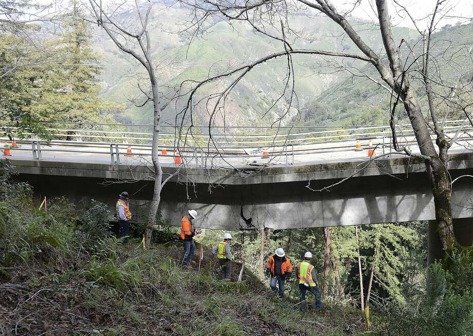 In this Feb. 22 photo, Caltrans engineers study the sagging Pfeiffer Canyon Bridge on Highway 1 in Big Sur. The bill to repair state roads hammered by winter weather is nearly $600 million. Photo: David Royal, Associated Press