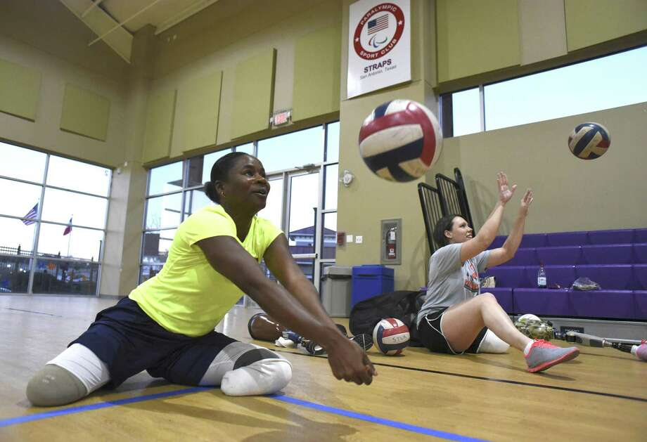 Kari Miller, left, a military veteran who lost her legs to a drunk driver in an accident, and Lindsay Clark, who lost a leg to a birth defect, practice their sitting volleyball technique at Morgan's Wonderland on Thursday, Feb. 23, 2017. Photo: Billy Calzada, Staff / San Antonio Express-News / San Antonio Express-News