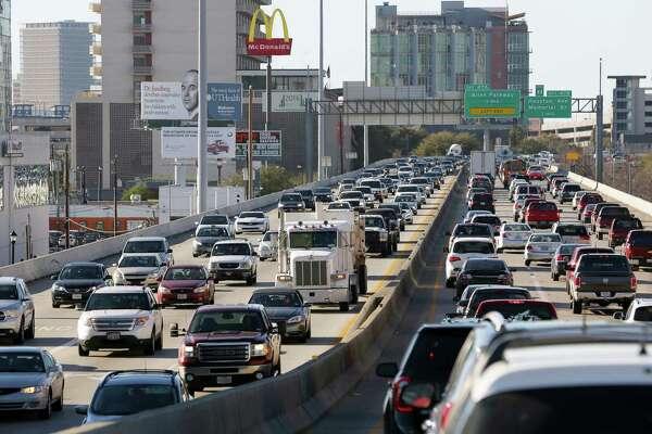 Traffic creeps along Interstate 45 where it is elevated near Pierce Street in downtown Houston on Feb. 23.