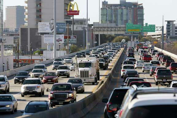 Traffic creeps along Interstate 45 where it is elevated near Pierce Street in downtown Houston on Feb. 23.