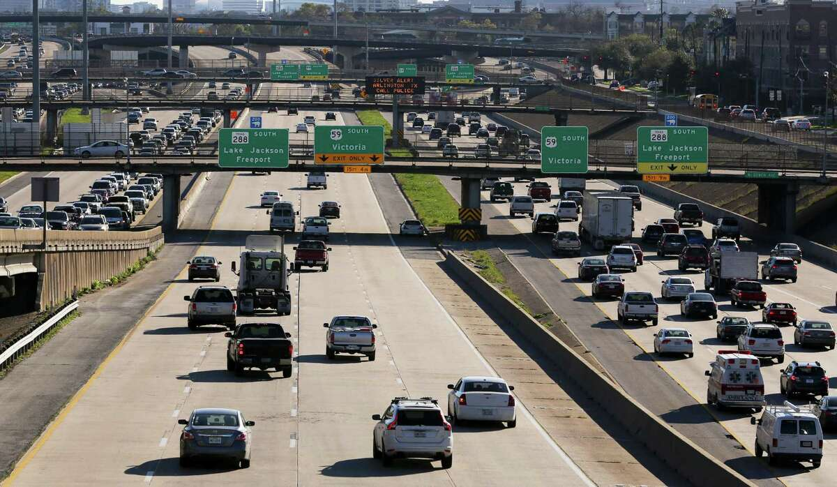 Traffic on Interstate 45, Interstate 69/U.S. 59 and Texas 288 converge south of Houston's central business district during afternoon rush hour on Feb. 23. TxDOT has a $3 billion plan to remake the freeways and move I-45 to the east side of downtown.