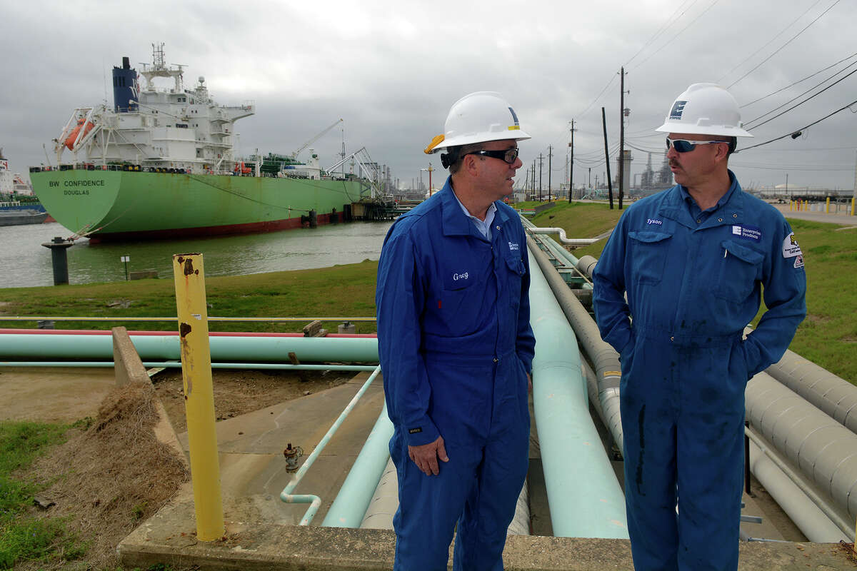 Greg DeLong, left, Enterprise Products Marine Liaison Senior Manager, and Tyson McMahon, Enterprise Products Operations Superintendent, discuss the day's schedule while in the background, a vessel is loaded with 500,000 barrels (22 million gallons) of propane at an Enterprise Products dock on the Houston Ship Channel on Feb. 10, 2017. NEXT: See major pipeline projects in Texas.
